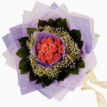 12 adet gül ve elyaflardan   Muş çiçekçi mağazası