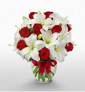 Muş hediye çiçek yolla  1 dal kazablanka 11 adet kırmızı gül vazosu